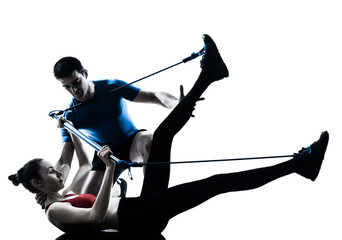 coach man woman exercising gymstick