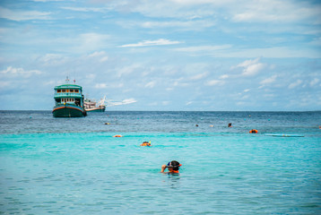snorkeling with crystal clear water