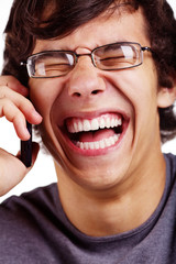 Laughing guy with cell phone close up