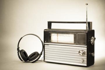 Retro radio and headphones old vintage sepia photo
