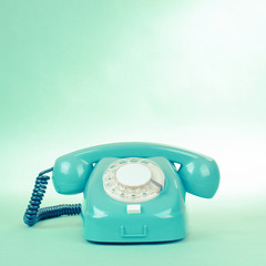 Retro mint green telephone photo with empty place for text