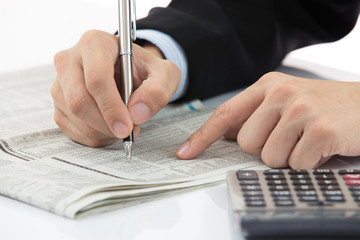 Hand with finance report