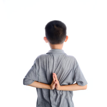 young boy doing yoga exercise in Virasana or Hero Pose with reve