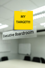 """Yellow note message """"my tarket' on Meeting room,take photo from"""
