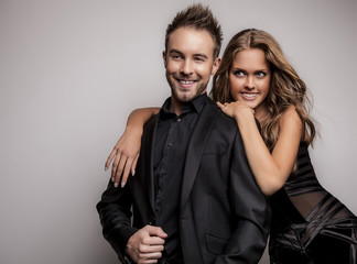 Attractive couple dressed in black fashionable clothes.