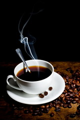 Coffee cup and beans on a Black background