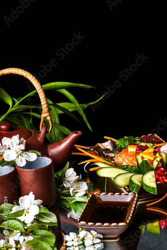 Asian Teapot With Jasmine Flowers And Food Stock Photo And Royalty