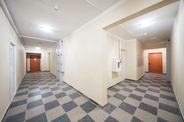 Clean corridor with the floor with checkerboard pattern