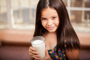 Little girl with a glass of milk