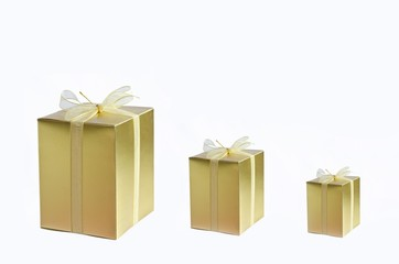 three golden gift box on wi\hite background