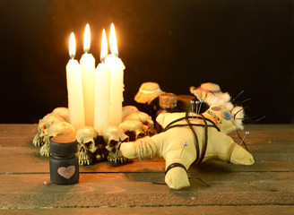 Pierced voodoo doll with love potion bottle