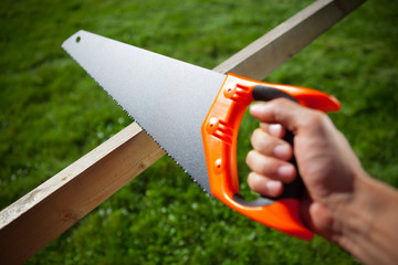 cutting plank with hand saw