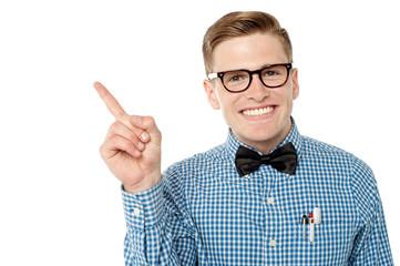 Smiling nerd pointing away