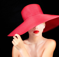 portrait of attractive woman in red hat