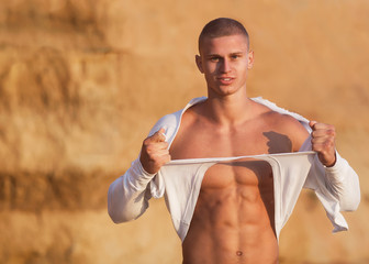 Sexy shirtless fit male model against