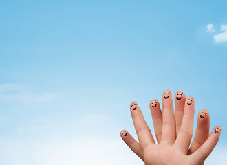 Happy smiley fingers looking at clear blue sky copyspace Wall mural