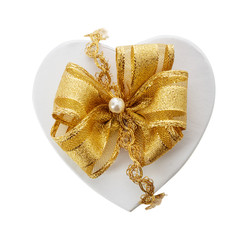 Romantic heart shaped gift and gold bow