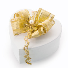 Heart shaped gift box with gold bow