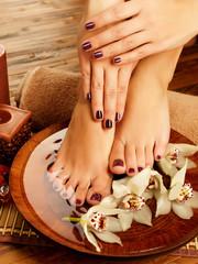 female feet at spa salon on pedicure procedure