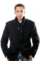 portrait of serious adult man  in black coat