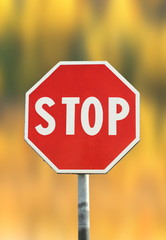 stop sign over autumn background