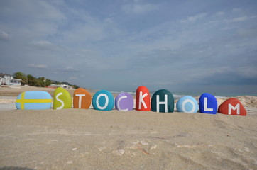 Colourful souvenir of Stockholm with stones on the sand