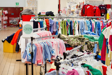 sale of children's wear in abstract supermarket