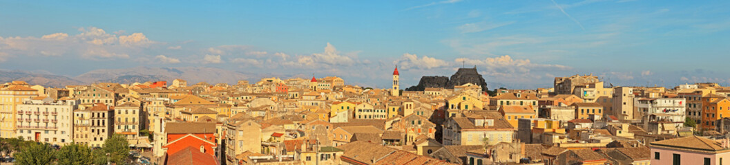Panoramic shot of Corfu city with blue cloudy sky. Sen from abov