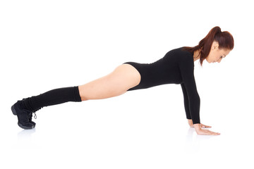 Athletic young woman doing press ups