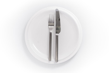 stainless knife and fork in a chine plate isolated on a white ba