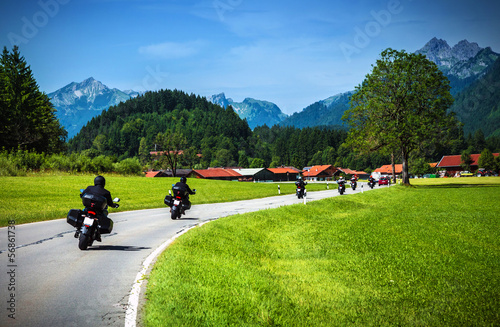 Wall mural Motorcyclists on mountainous road