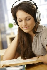 Portrait of learning woman with headphones