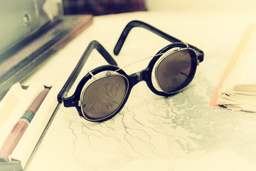 Old glasses and pen on the vintage document