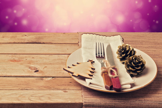 Christmas retro table setting with wooden ornaments