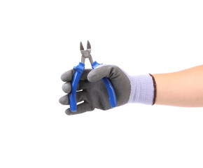 Hand holding pliers.