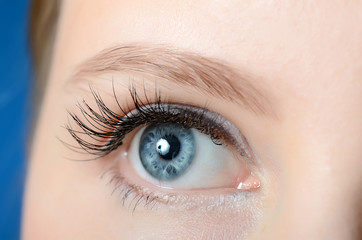 Female eye with long eyelashes close-up