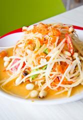 Thai cuisine - hot and spicy papaya salad