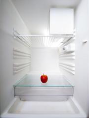 apple in an empty refrigerator