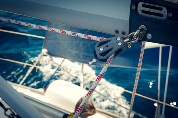 Rope and pulley on boom, sailing boat