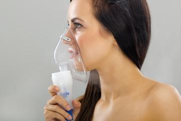 woman keeping inhale mask