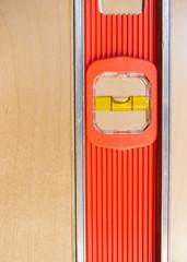 Old Door Gets Installed Leveled up By Long Orange Level Tool
