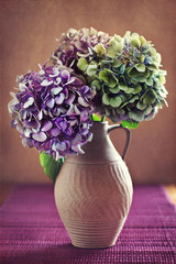 purple hydrangea flowers in an old clay jar.
