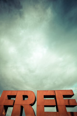 Capital letters FREE with cloudy sky