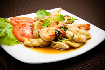 Spicy fried squid and shrimp with basil leaves Thai food