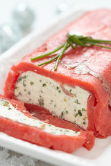 Cheese terrine wrapped with smoked salmon