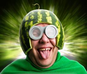 Obraz Funny man with watermelon helmet and googles - fototapety do salonu