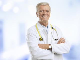 Senior Male Doctor Smiling In His Office