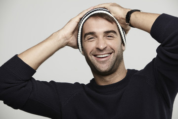 Portrait of man in woolly hat, smiling