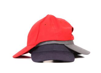 Stack of working peaked cap.