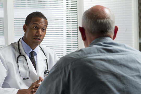 African American doctor with older patient, horizontal